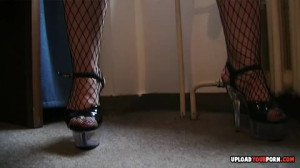 Hot blonde in fishnets plays with a toy